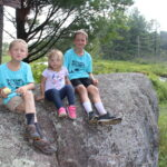 Kids in Kids' Camp Shirts at Baker Woods on a Rock